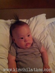 Still got the fauxhawk mojo after bath time, baby.