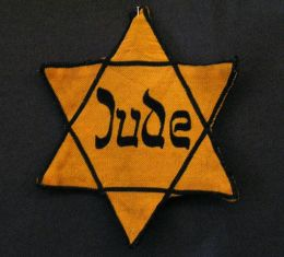 Star of David used by Nazis to identify Jews.  People with disabilities were also publicly marked.  (photo from Wikipedia commons)