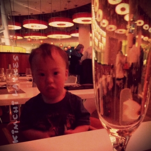 Not all that pleased at dinner.  Mommy, on the other hand, was very pleased with her champagne.